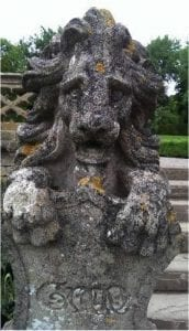 One of a pair of lions in the rose garden